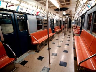 A vintage car on display at New York Transit Museum that visitors are able to board.