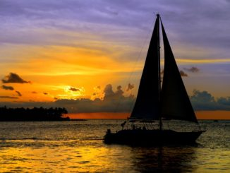 New York sailboat cruises along with a beautiful sunset in the background