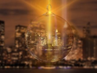 New York's skyline inside a Christmas decoration with a yellow light shining through
