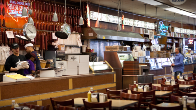 customer waits as food is prepared at Katz's Deli New York
