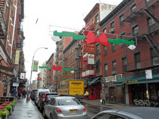 Street view in little italy new york with street decorations above the road