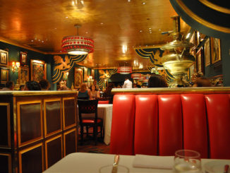 Red leather seats, gold ceiling and green walls decorate the Russian Tea Room NYC