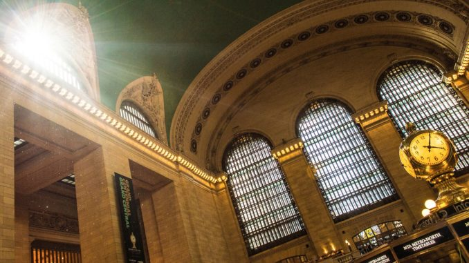 Sunlight shines through window at Grand Central Station