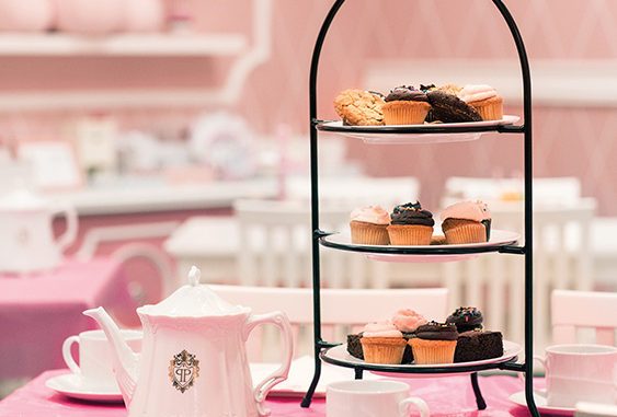 Cakes and tea sit on a table at a Eloise-Themed Afternoon Tea at The Plaza Hotel New York