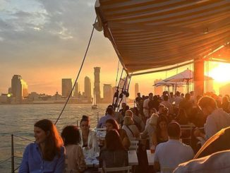 Patrons dining at Grand Banks Oyster Bar located on schooner on the Hudson River.
