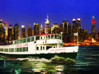 Circle Line Ship sails up the Hudson River with New York skyline in background