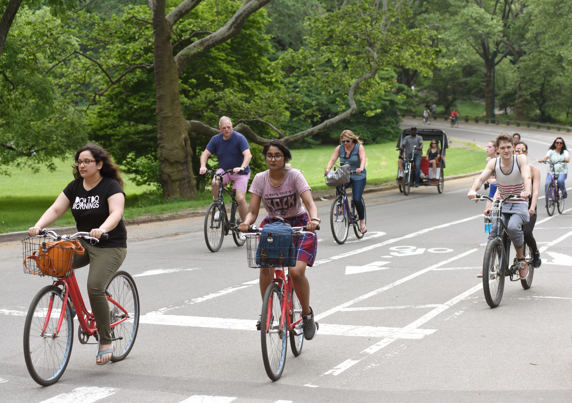 an image of people riding bicycles on one of the new york sightseeing tours