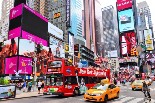 Gray Line Sightseeing Bus in New York takes passengers through Times Square