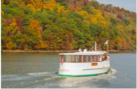 A Classic Harbor Line yacht cruising up the Hudson River on a Fall Foliage Cruise.