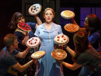 Jenna in Broadway's Waitress The Musical showing off the pies she has just baked.