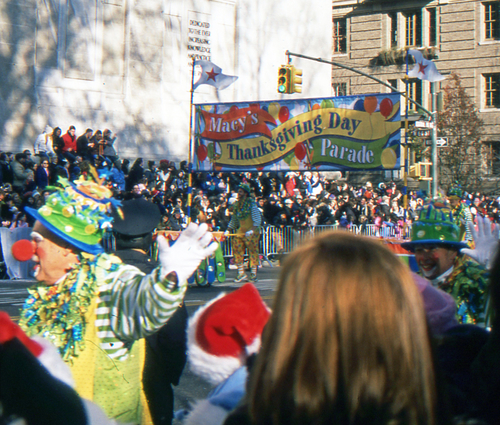 Clown walks by in Macy's Thanksgiving Day Parade in the streets of NYC