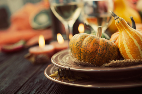 Autumn table setting with pumpkins. Thanksgiving dinner and autumn decoration.