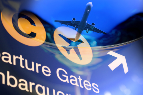 Airport sign with an airplane taking off