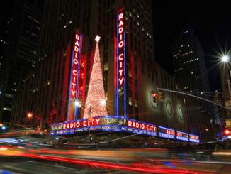 : Bright Christmas lights of Radio City Music Hall in New York City at night.