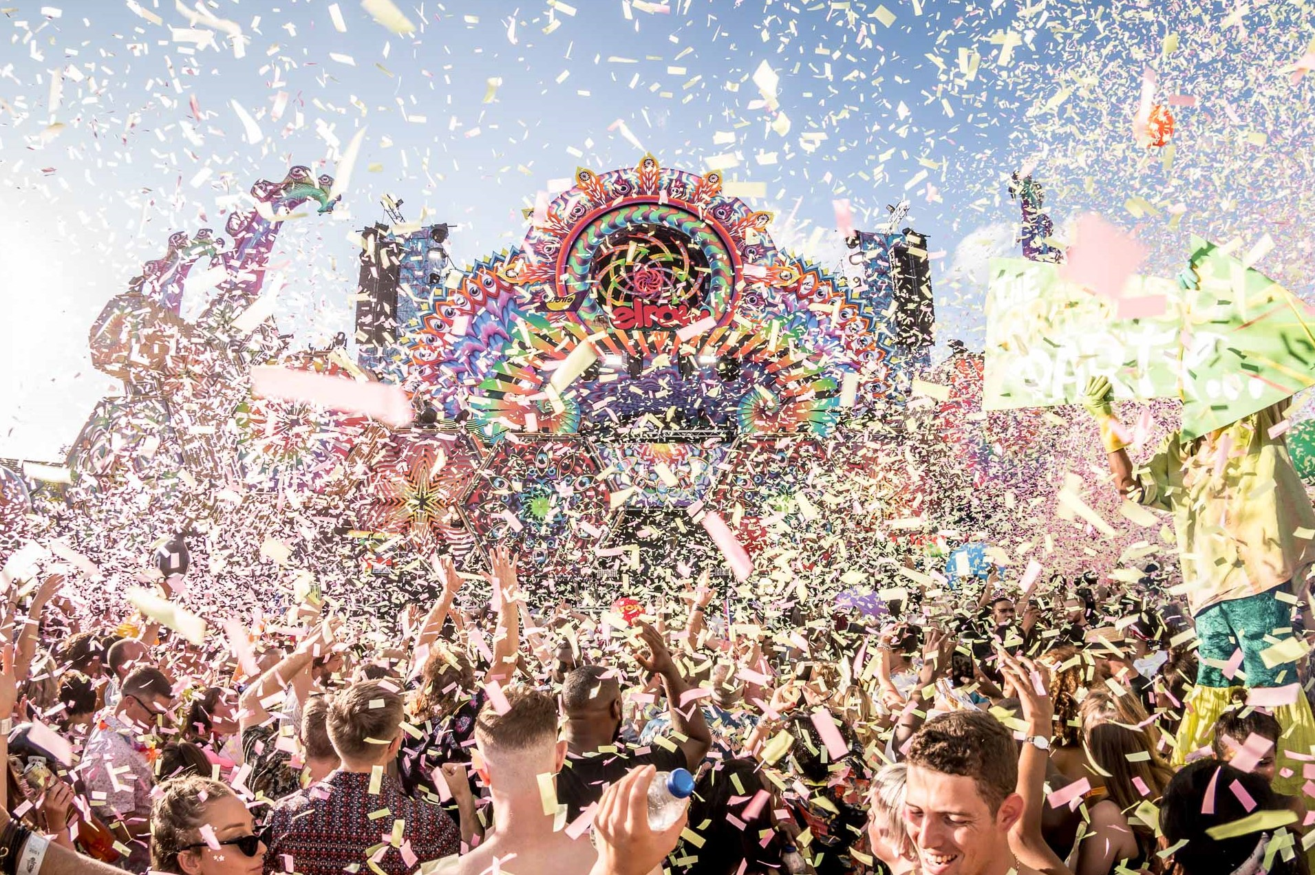 Crowd at Elrow dance underneath confetti in front of main stage - new york in december