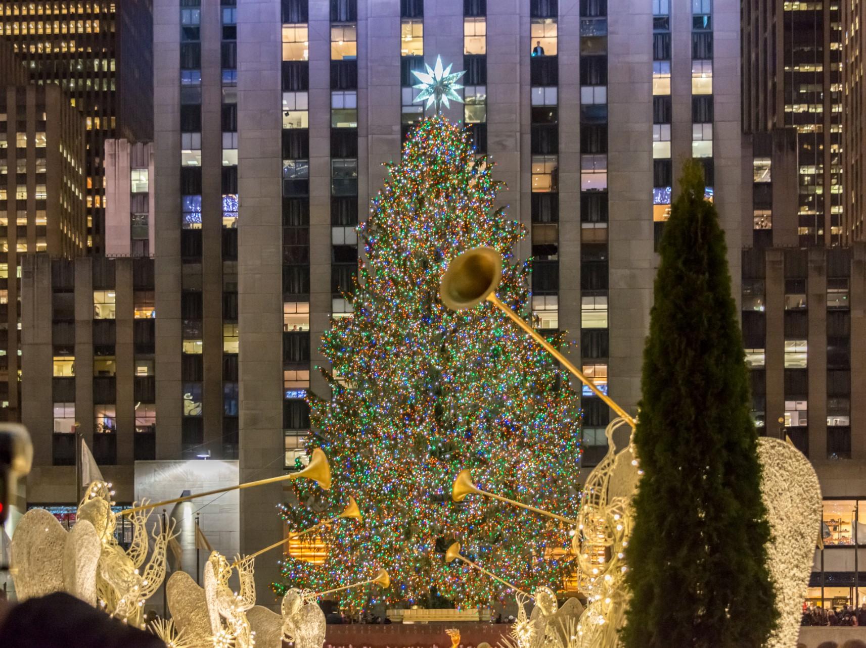 The famous rockefeller tree lit up fpr christmas - new york in december