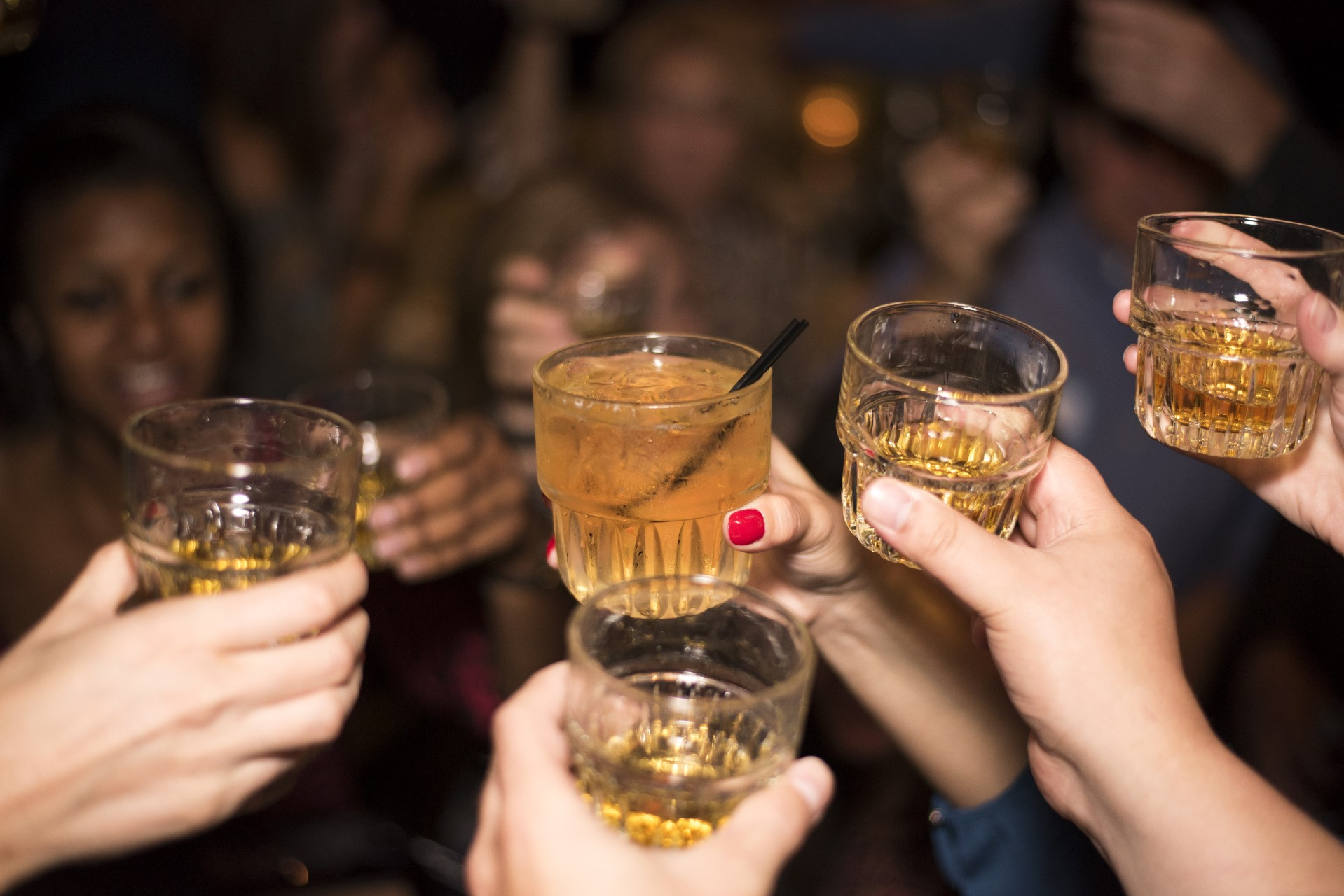 group of people toast whiskey glasses - new york in december