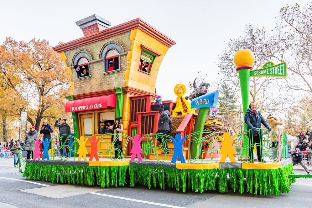 colourful fun house passes by on Macy's Thanksgiving parade