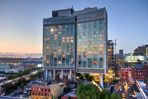 View across Manhattan Meatpacking District and Chelsea from above, at sunset with The Standard Hotel in view.