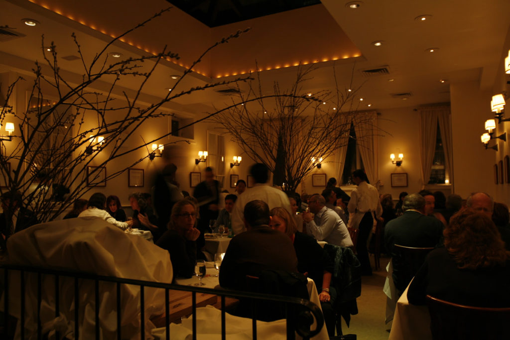 diners sit and chat while waiting for their food Inside Babbo Restaurant New York