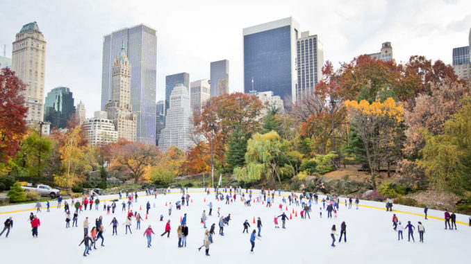 New York City ice-skaters having fun in Central Park - Cheapest time to travel to New York City