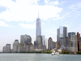 The Manhattan skyline overlooking a cruise ship on the Hudson River - Circle Line Sightseeing Cruises