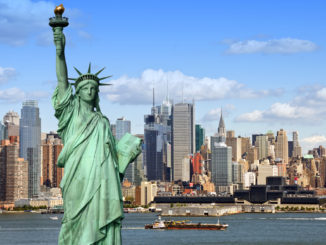 A cityscape view of New York's attractions including the Statue of Liberty