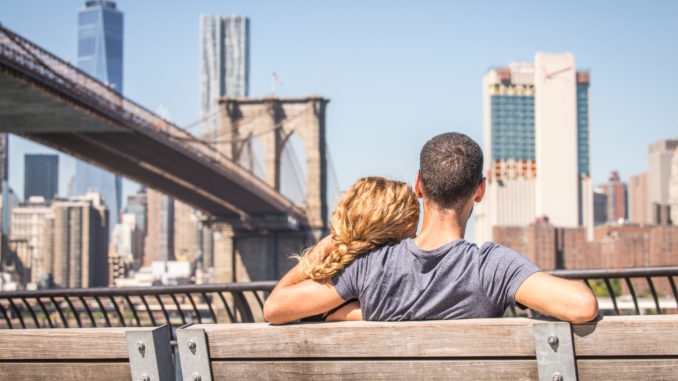 loved-up couple enjoying the view of NYC - most-romantic hotels in new york