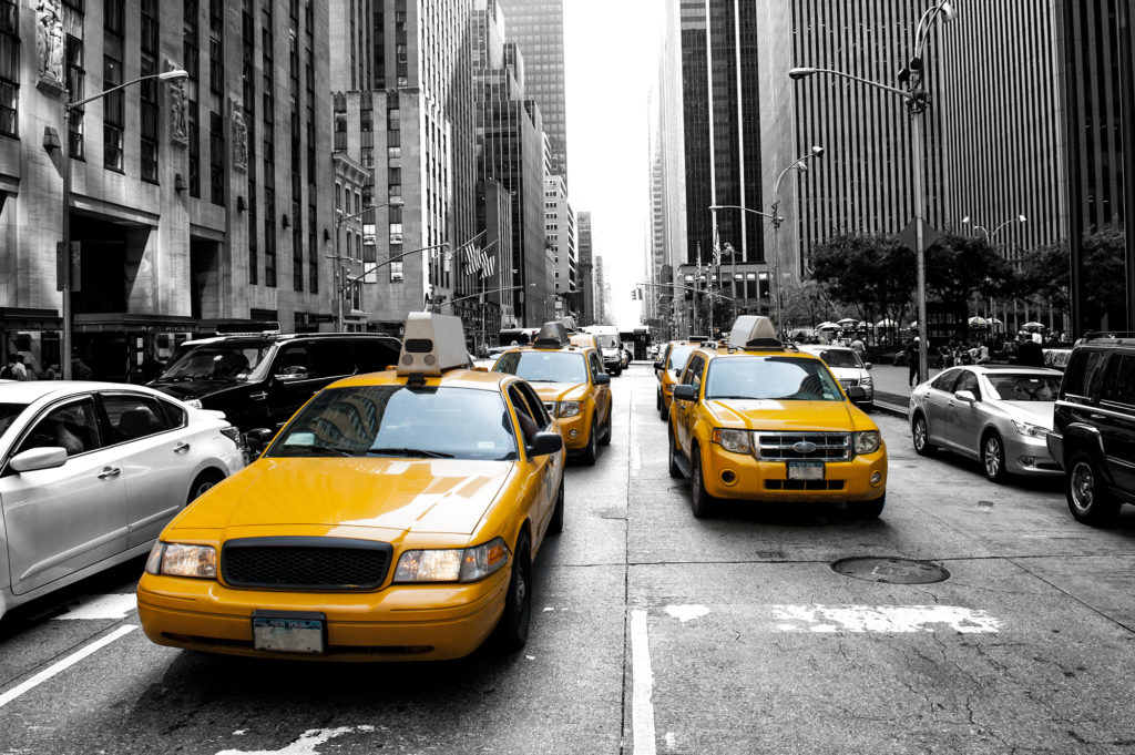 new york's iconic yellow taxis getting from jfk to manhattan
