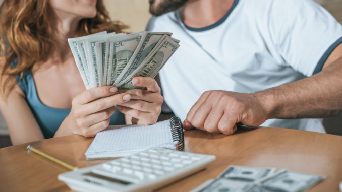 couple holding money budgeting-for-holiday how much spending money new york