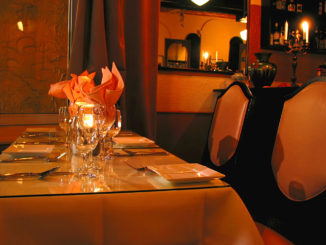 candle lit table ready for diners to arrive at one of the most romantic restaurants in new york