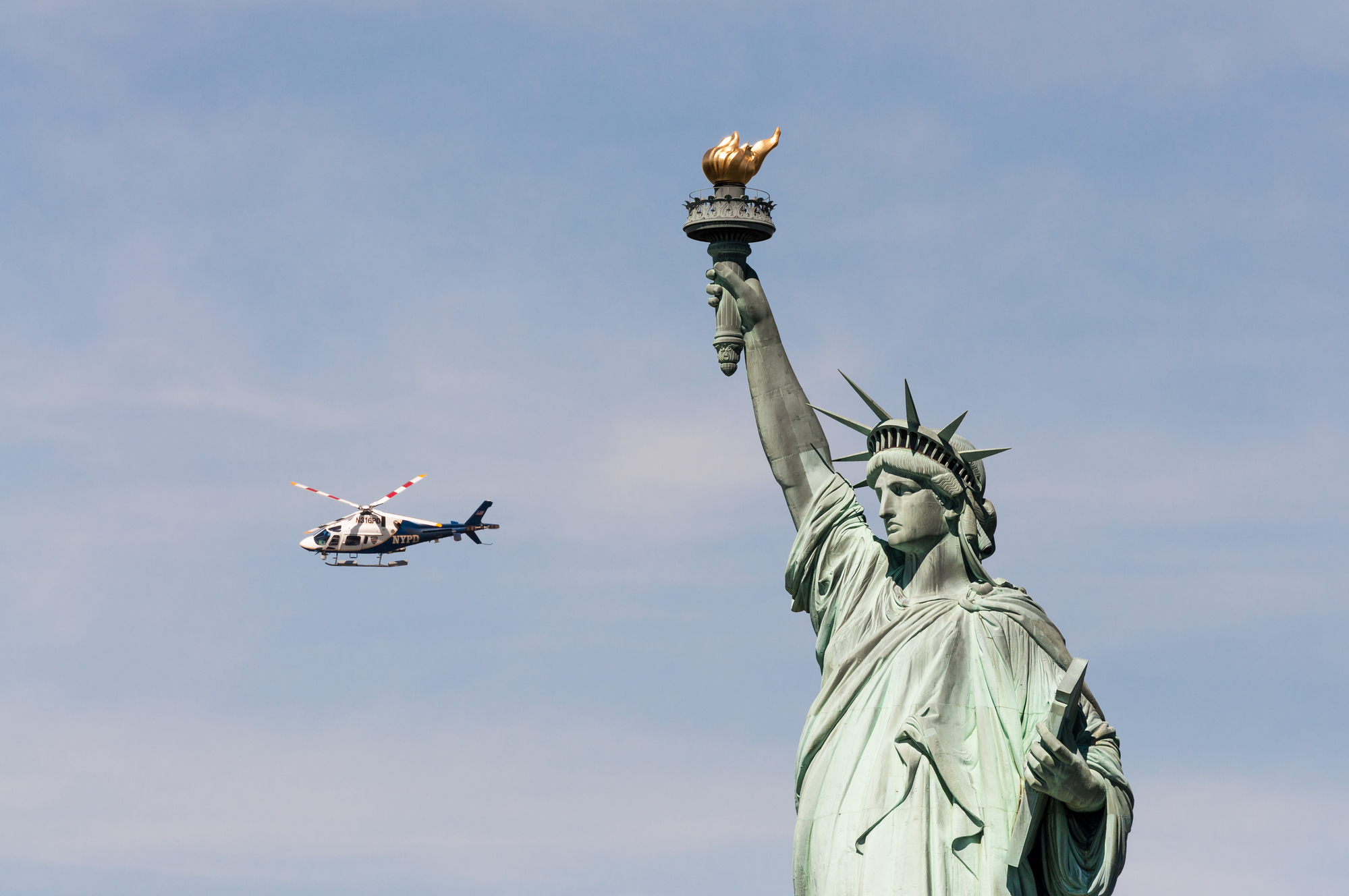 pic-of-helicopter-flying-past-statue-of-liberty-how-much-spending-money-new-york