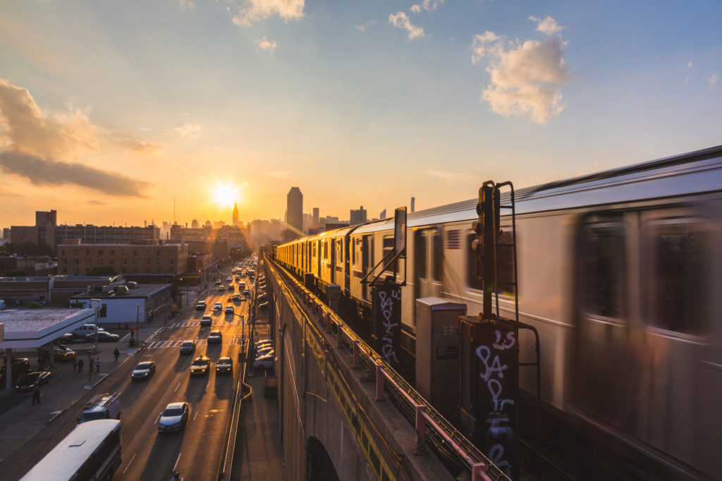 new york subway with sunset in background