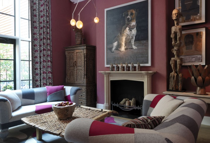 beautifully-decorated room with nice sofas a huge pic of dog on the wall