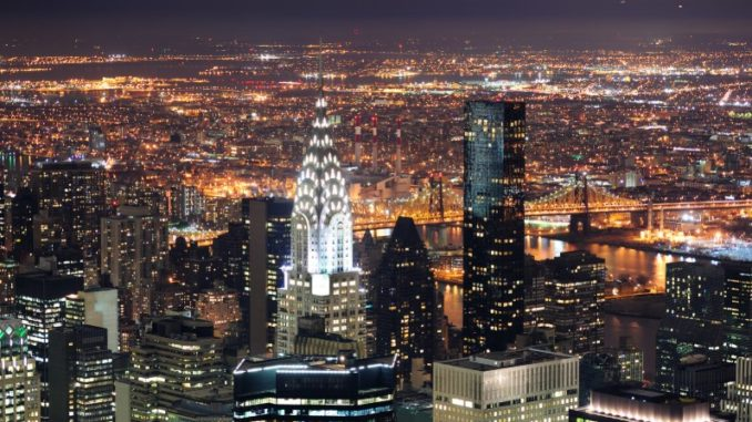 the Chrysler Building, along with the rest of New York, lit up at night
