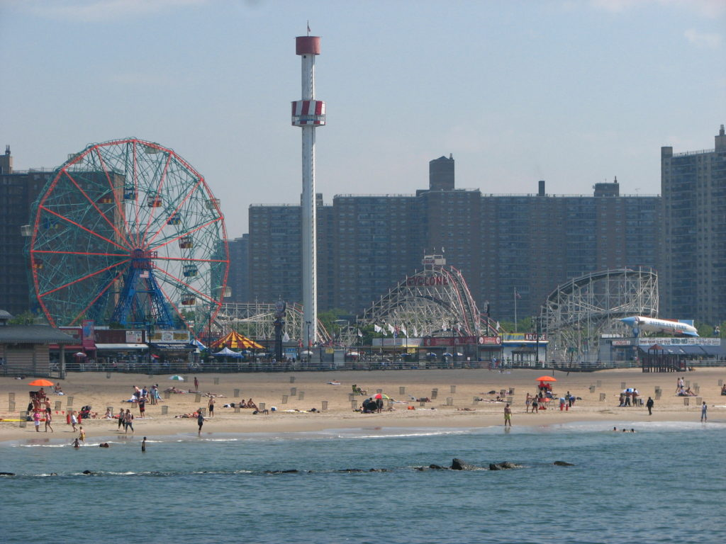 coney island beach with the fun fair in the background