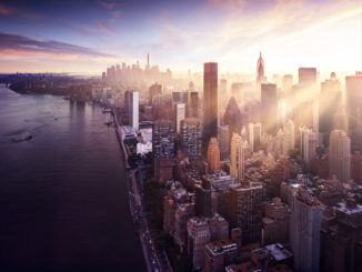 view over new york city with sun rising over skyscrapers
