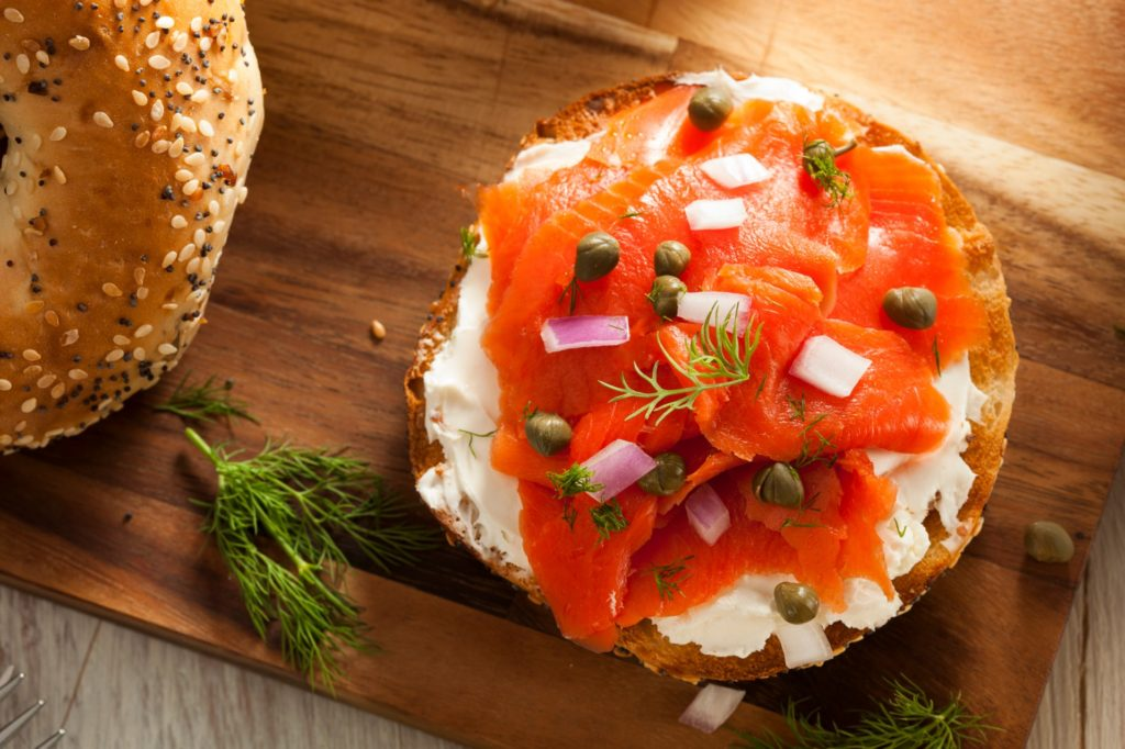 bagel topped with cream cheese a lox - things to eat in new york