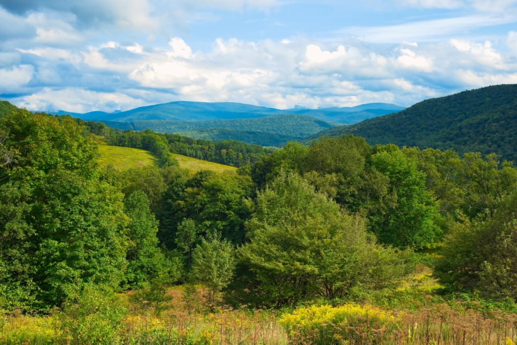 lovely view of the mountains over the hills at the catskill national park - national parks in new york