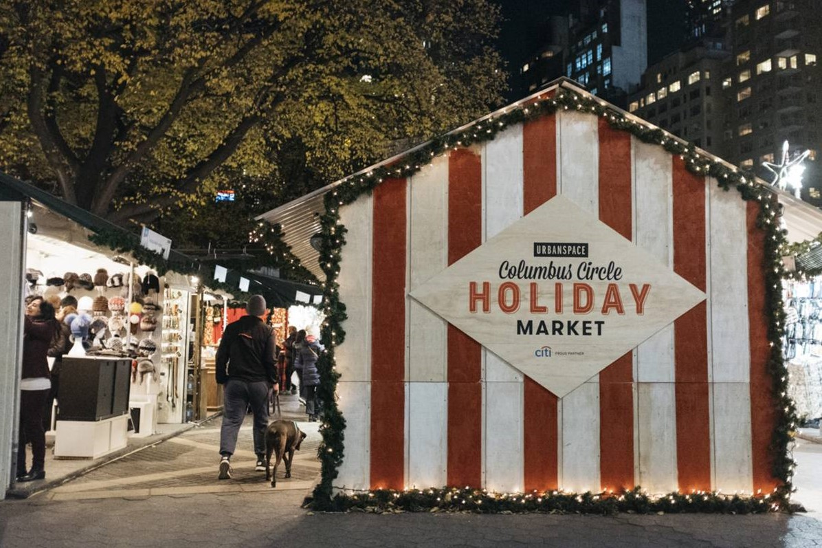people shopping at holiday market in new york in november