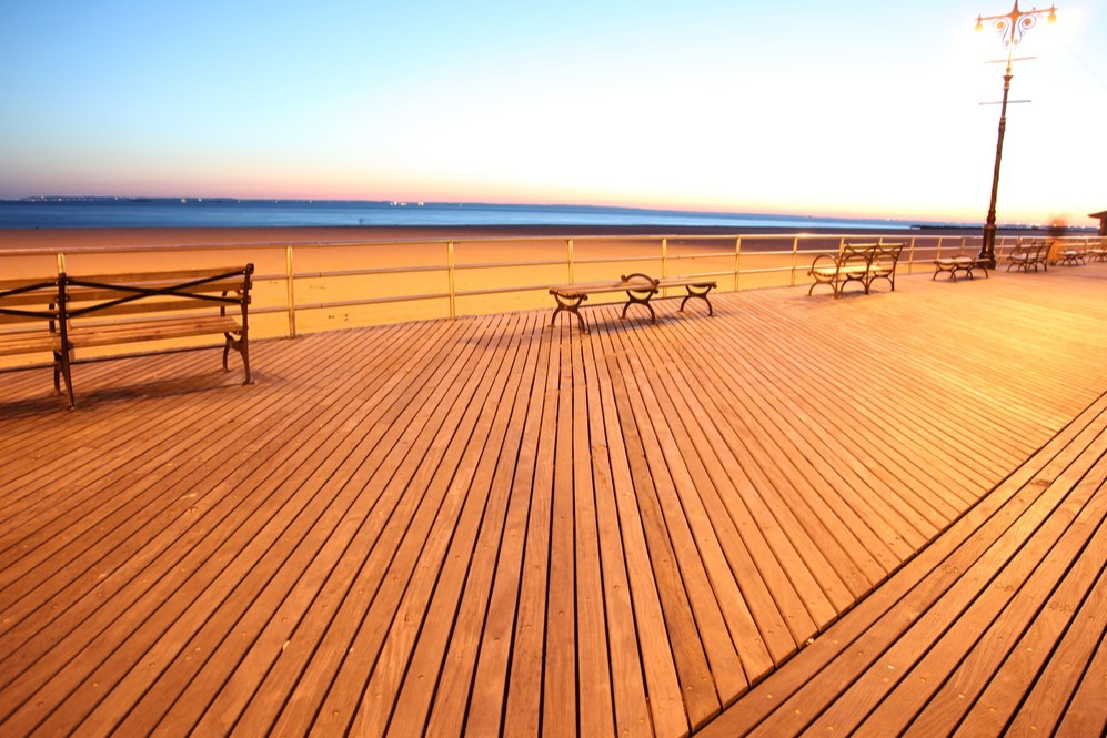 Empty boardwalk and benches in front of Brighton Beach