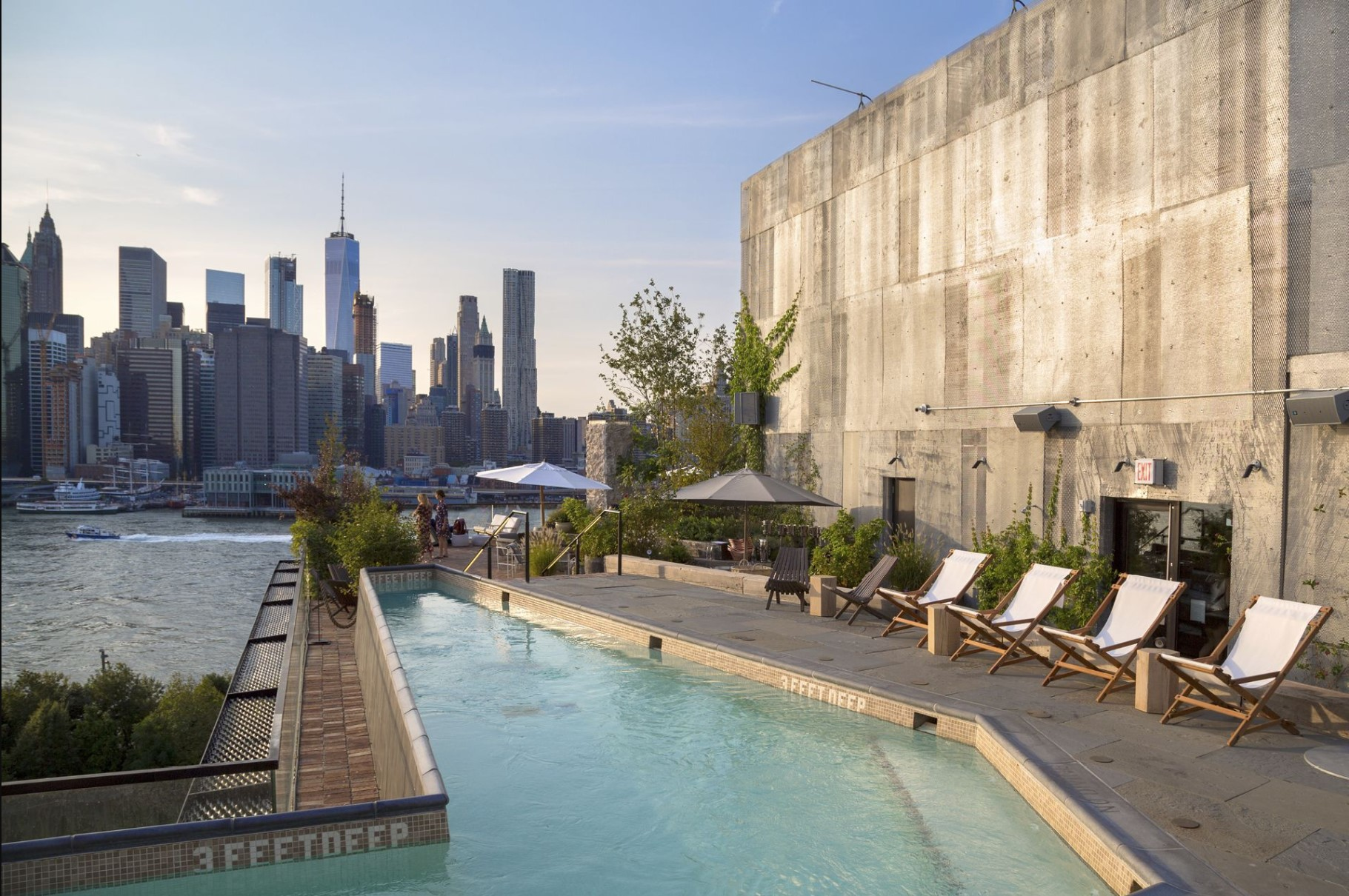 Rooftop pool with Manhattan skyline in background