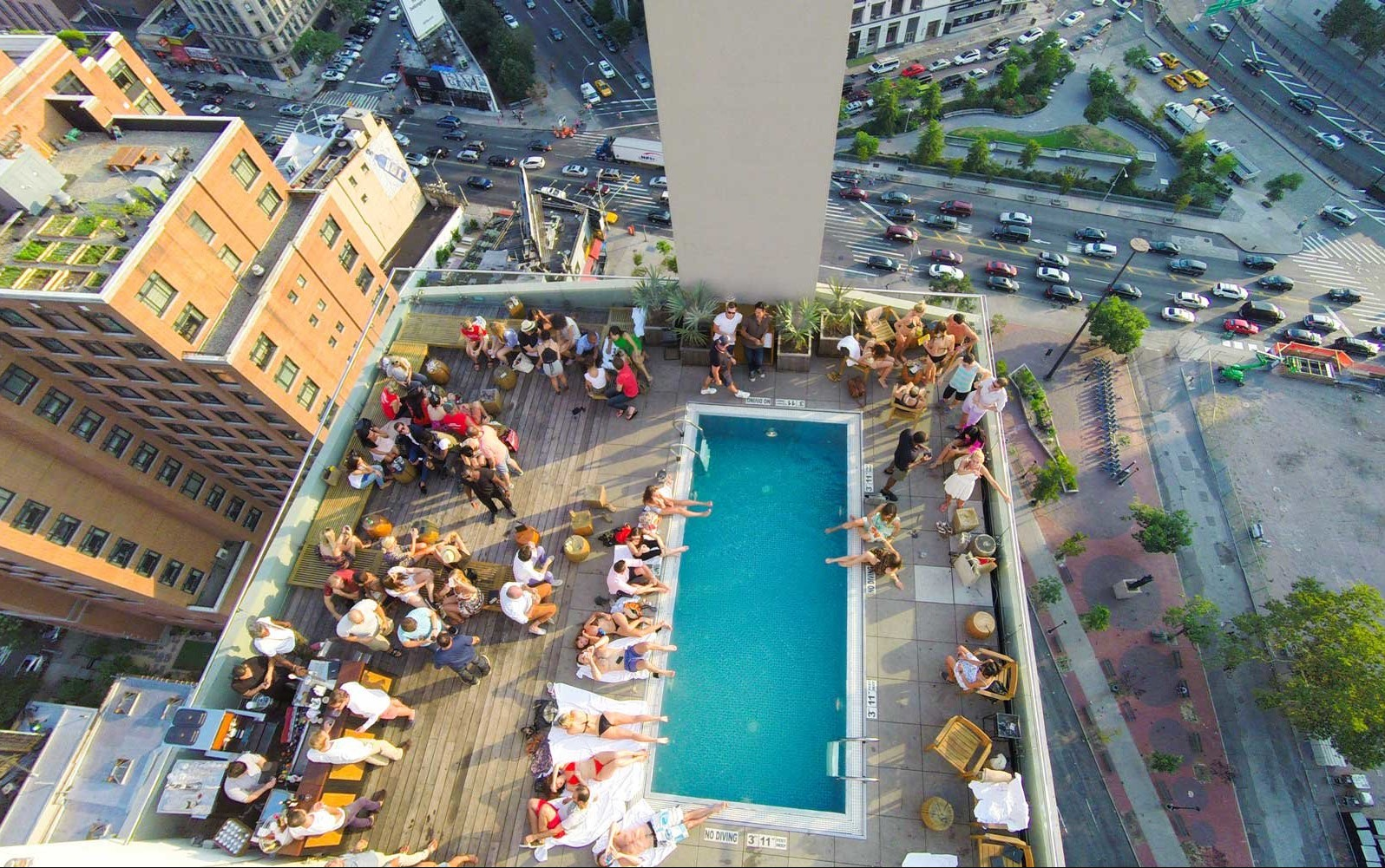 Aerial shot of pool party on a rooftop bar