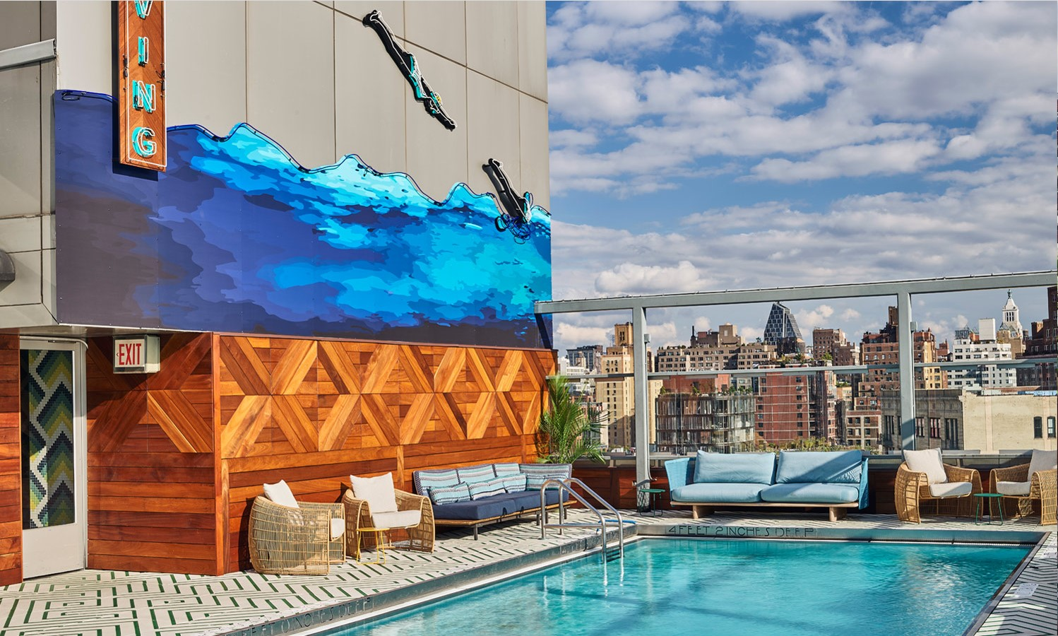 Wall mural on the side of hotel overlooking a swimming pool